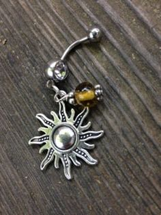 Hey, I found this really awesome Etsy listing at https://www.etsy.com/listing/190196995/tribal-style-silver-tone-sun-belly-ring