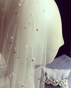 Unique colored stones and pearls were used on this veil to match the brides dress so perfectly!✨ . . . #clarissaboutiquepittsburgh…