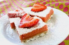 Sweet and tangy fresh strawberry lemon bars. Pretty in pink, these bars are a sublime twist on the classic lemon bar. Perfect for a summer barbecue