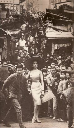 BOAC ad? Black and white. classic. vintage. asia. caucasian. wide-brimmed hat. fashion. travel.