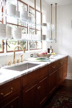 "Kitchen Trends The New Traditional Kitchen — Heather Hungeling Design Shelving in front of windows is having a ""moment"" in kitchen design for such as in this beautiful kitchen by Katie Hackworth. Home Decor Kitchen, Kitchen Furniture, Diy Kitchen, Kitchen Ideas, Kitchen Modern, Cheap Kitchen, Kitchen Sink, Decorating Kitchen, Modern Kitchens"