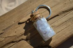 Genuine blue lace agate stone chips in a vial on a key ring. Glass vial keychain filled with small blue lace agate stones. The key chain was