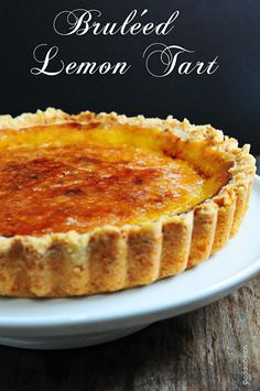 Lemon Tart recipe with a Bruleed top and a Shortbread crust. Makes a great make-ahead dessert when entertaining.