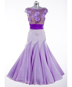 DSI London - 372987 Lilac Ballroom Dress inLimited Edition 3D LaceinLilacoverTan bodice. ContrastingPurple Satingives this dress a cinch at the waist. Completing this dress is aLilac SatinandGeorgetteskirt