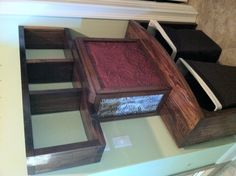 Custom built bathroom accent piece that houses towels, etc & hides dirty clothes baskets.  Made from 150 year old heart pine & old ceiling tiles! Call The Green Door Company 662-380-5074.