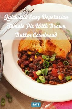 Hearty bean chili underneath a crisp brown butter cornbread crust