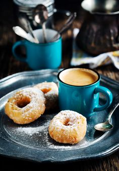 Donuts and coffee on dark wooden table - Donuts and coffee on dark wooden table