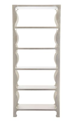 197a60805ccf This Hollywood Regency etagere shines in silver leaf. With curvaceous  detail on the front and back framework
