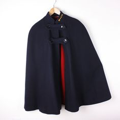 reversable nurses cape -- when I was a student nurse in London, we were told that if we are 'on duty' we wear in on the red side, & navy blue means we are 'off duty'..