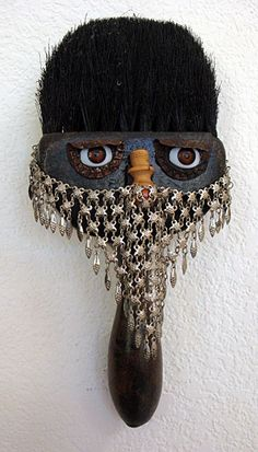 A wonderful old paint brush with a metal veil. I think the metal veil came from Guatemala years ago. The eyes are bottle caps with doll eyes and the nose is a piece of wood. Paint Brush Art, Paint Brushes, Sculpture Art, Sculptures, Funky Art, Scrapbook Designs, Assemblage Art, Recycled Art, Diy Arts And Crafts