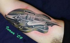 Nicely done Guitar tat.