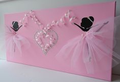 Pink ballerina wall art. Large 12X24 canvas. Large 12X24 canvas with two dancing ballerinas and rhinestone heart. Canvas backgrounds and ballerina silhouettes are painted with acrylic paint. Dancers are decorated with tulle skirts, silk ribbons and rhinestones. Large rhinestone heart is a vocal point of this girly canvas art; made of single rhinestones and silk ribbons.