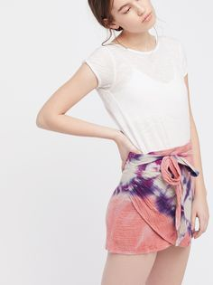 When The Tide Turns Mini | All cotton mini skirt featuring a cool tie-dye print with a subtly wrapped design and an effortless tie at the waist.  * Lined * Hidden side zipper closure