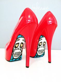 Painted soles on bright red shoes! Fun.