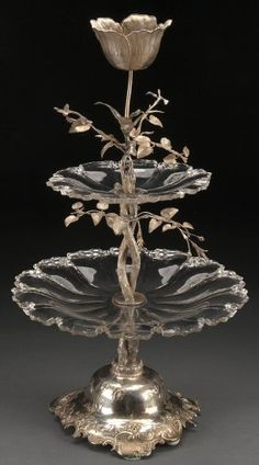 """A VERY FINE DUTCH SILVER AND CUT CRYSTAL CENTERPIECE EPERGNE, 1853. Stamp hallmarks including """"Z"""" probably for Pieter Zollner and William Beijoer (1849-1871) comprising a silver entwining stem with extending foliage supporting two scallop cut crystal trays below a tulip blossom finial raised on a scalloped floral repousse and chased bell form base. Additionally stamped """"Pde Meyer te'Hage."""""""