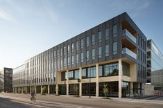 111 East Grand by Neumann Monson Architects - Rethinking The Future Surf And Turf, Neumann, Precast Concrete, Wood Windows, Exposed Wood, Commercial Architecture, How To Level Ground, Wood Construction, Wood Design