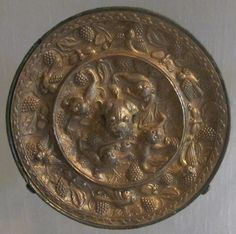 Tang dynasty (618-906) bronze mirror with lions and grapevines design, Honolulu Academy of Arts.  The Tang Dynasty is another peak period for the development of the bronze mirrors. Bronze mirrors were very popular in the Tang Dynasty due to the improvement of the metal casting techniques and the improvement of people's lives. Thick and delicately decorated, the bronze mirrors of the Tang Dynasty were as pure as silver with more tin in the raw materials.