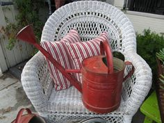 Red watering can  Im bringing one just like this to the Sale at Summit Farms