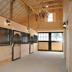 I want a super classy barn like this with cedar stalls and a freaking chandelier. Why? Because I can.
