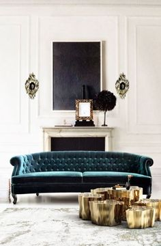 = teal sofa, gold coffee table cluster and blackboard artwork