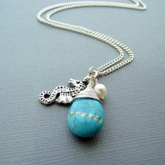 Wire wrapped turquoise charm necklace with by jinjajewellery, £7.00