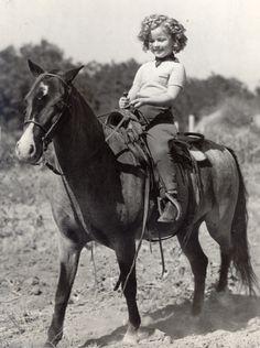 Shirley Temple on horseback, 1930s.