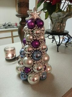 Made from a styrofoam cone and lots of old Christmas ornaments. #ornamenttree #ornaments