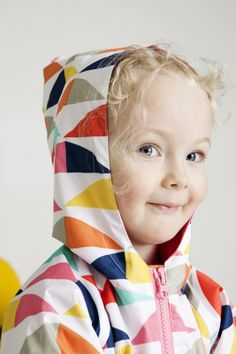 Scandinavian style Arvoitus raincoat from Marimekko Kids´ Collection S/S 2014.  Marimekko collections are known for colourful patterns and 70's style and playful attitude.