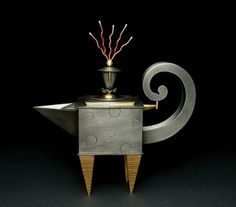 "Teapot with Wild Hair, 2006  Jon Michael Route  Pewter, Copper, Brass  11 1/2""H x 11""W x 3 1/4""D"