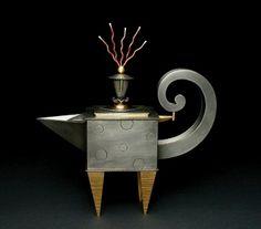 "Teapot with Wild Hair, 2006  Jon Michael Route  Pewter, Copper, Brass  11 1/2""H x 11""W x 3 1/4""D"