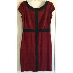 Ellen Tracy Houndstooth Colorblock Dress Good condition. Some pilling, but it mostly just blends into the fabric. Really cute Ellen Tracy dress. Red and black houndstooth plaid pattern. Large black stripes to create colorblock look. The red material feels slightly like flannel. Fully lined inside with a smooth material. Small slit in the bottom of the back. Zips all the way up the back. Size 6. +All offers welcome Ellen Tracy Dresses Midi