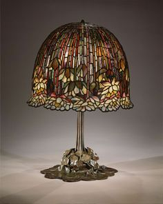 Louis Comfort Tiffany (1848-1933)  Tiffany Studios (1902-1938)  Water lily table lamp, 1904-15   Leaded Favrile glass with bronze base