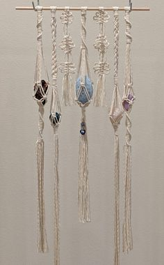 I made a thing. Instead of plant hangers, crystal hangers. I wanted to make something that allows the crystals to be swapped out. I have three tiny lemurian quartz points attached to the piece but other than that, all of the crystals are removable. Macrame Plant Hanger Patterns, Macrame Wall Hanging Diy, Macrame Plant Hangers, Macrame Art, Macrame Design, Macrame Projects, Macrame Knots, Macrame Patterns, Macrame Bracelets