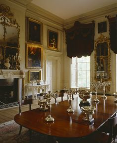 "The Square Dining Room at Petworth, with its rococo furnishings and the ""wizard earl"" in his painting on the wall"