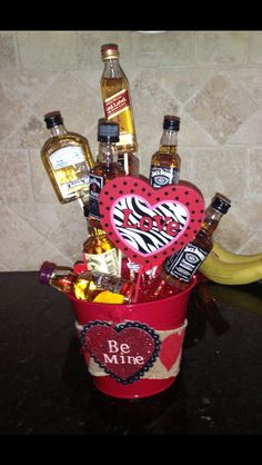 Liquor bouquet I made for my boyfriend for Valentine's day- super easy to make! Mini liquor bottles, skewers, styrofoam ball for the anchor, pot and decorations of your choice, and a hot glue gun! Great for Valentine's Day or a couple's shower. Be My Valentine, Valentine Gifts, Liquor Gift Baskets, Liquor Bouquet, Mini Liquor Bottles, Styrofoam Ball, Couple Shower, Jack Daniels, Glue Gun