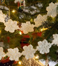 Crochet a garland of white snowflakes to adorn your Christmas tree or hang from a doorway this holiday season. This Christmas crochet pattern is for intermediate level but works up quickly.