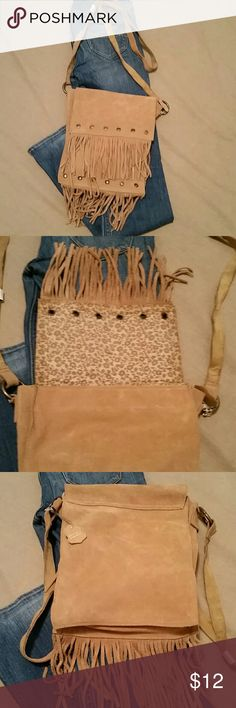 NWOT Suede fringed crossbody bag  Genuine leather 10 inches tall 8 inches wide.  Still has genuine leather tag attached.  Never been used. Bags Crossbody Bags