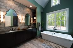 This master bathroom is at one with nature! The Laurelwood #5024.