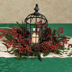 Give your holiday decor a soft, gentle glow and a display of an appealing floral medley with the Holly Berry Birdcage Candleholder. Metal birdcage has. Christmas Bird, Christmas Lanterns, Christmas Door Decorations, Christmas Room, Christmas Centerpieces, Holiday Wreaths, Christmas Crafts, Christmas Ornaments, Holiday Decor