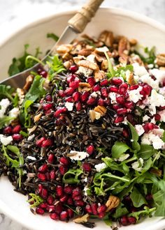 This Wild Rice Salad is a salad for celebrations! Stellar flavour combination - wild rice, pomegranate, pecans, rocket / arugula, green onions, cranberries and feta. www.recipetineats.com