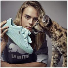 """Kering brand Yves Saint Laurent had a perfume advertisement featuring a model stroking a live leopard. Worst of all was Alexander McQueen, another Kering brand, which bought a taxidermied tiger from a German zoo to use as an ad prop in 2010.Will you please help us politely convince Kering Group to implement a """"no wild animals in advertising"""" policy across all of their brands? This would be a major win for big cats used as advertising props and set a new standard for the fashion industry!"""