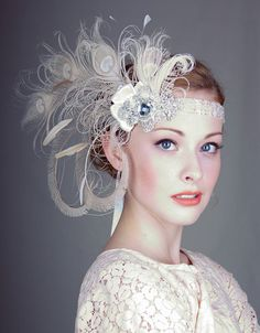 Ivory Peacock Feather Flapper Headband. Stunning spray of hand curled peacock feathers in ivory. Champagne hand curled swords mixed with peacock fronds, ostrich and burn't coque feathers. Decorated with exquisite silver beaded and embroidered applique. Beautiful beaded trim in silver and ivory with long ivory silk ribbon ties. By 'bluesugarbridal' on Etsy.