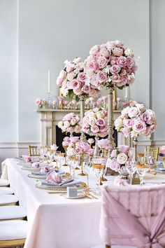 Wedding reception top table inspiration - rose themed decor (BridesMagazine.co.uk)