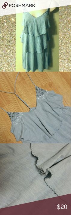 AEO Headed Ruffle Dress Gorgeous beading, t-back, adorable ruffles fit like peplum. Gray-light blue, missing a few beads hanging off ruffles can't even see though. Dresses