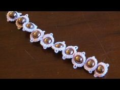 Needle tatting: Split ring with beads in the middle - YouTube