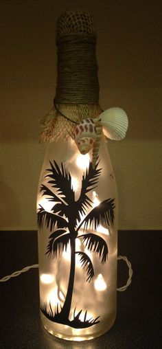 Items similar to Lighted Wine Bottle/ Decoration/ Gift/ Beach House - Beach Palm Tree/ Frosted Glass with Burlap, Jute and Sea Shells/ White Lights on Etsy - Crafts Wine Bottle Art, Painted Wine Bottles, Lighted Wine Bottles, Bottle Lights, Wine Bottle Crafts, Wine Glass, Decorated Bottles, Diy With Glass Bottles, Vodka Bottle