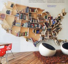 """The last page in October's edition of Dwell features architect Andrei Saltykov's American tribute and badass bookshelf. This guy lives in London, and he really likes the USA, or at least the structure of it. ""...The US has lots of straight-line divisions - great for holding books."" But what about the Palin state and those islands, you say. Well a shelf based on Hawaii hangs in the kid's bathroom, and Alaska is suspended in the upstairs bathroom over the tub.""    ​"
