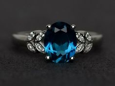 Oval cut blue topaz ring love gemstone ring engagement ring 925 sterling silver #Affinity Blue Topaz Stone, Blue Topaz Ring, Gemstone Engagement Rings, Engagement Ring Cuts, Silver Wedding Rings, Wedding Band, Wedding Dress, Silver Rings, Argent Sterling