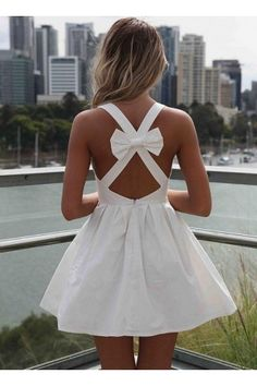White Sleeveless Mini Dress with Open Cross Bow Back