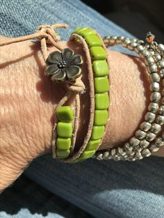 Two-hole bead, leather wrap bracelet. Love! Flower button.